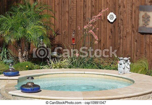 Backyard hot tub - csp10991047