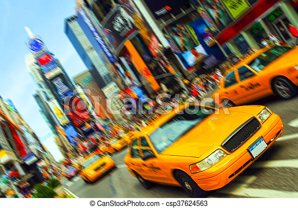 Beautiful Vibrant New York City Taxi, Times Square, Motion Blur. All logo and trademarks are blurred out. - csp37624563