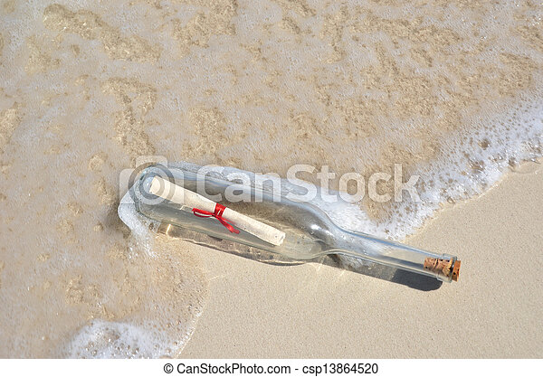 Bottle with a message on the beach - csp13864520