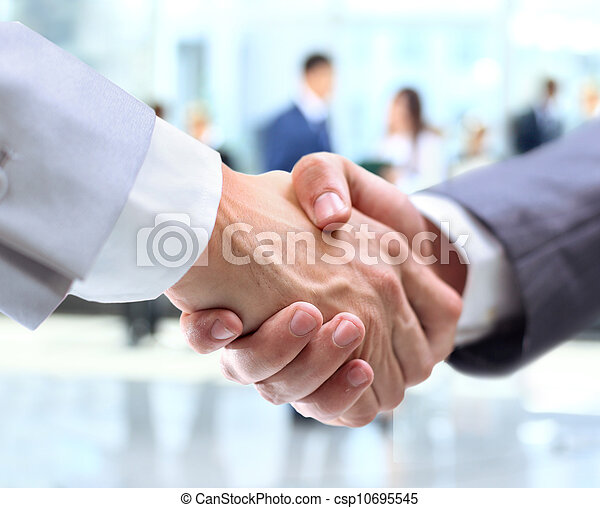 Business handshake and business people - csp10695545