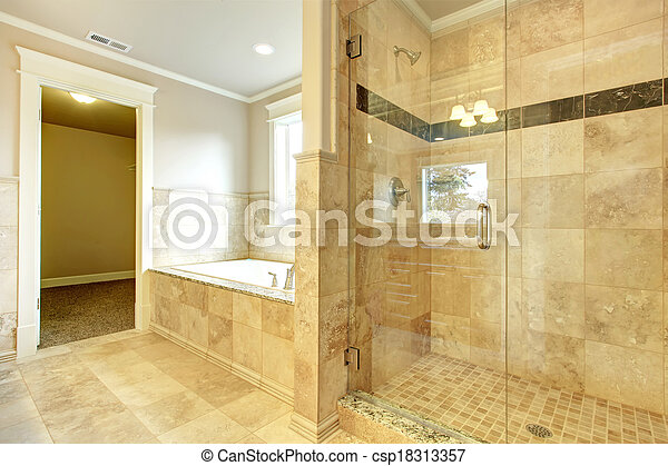 Cozy bathroom with tub and glass door shower - csp18313357