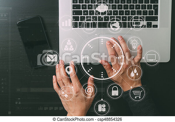 cyber security internet and networking concept. Businessman hand working with VR screen padlock icon mobile phone on laptop computer background - csp48854326