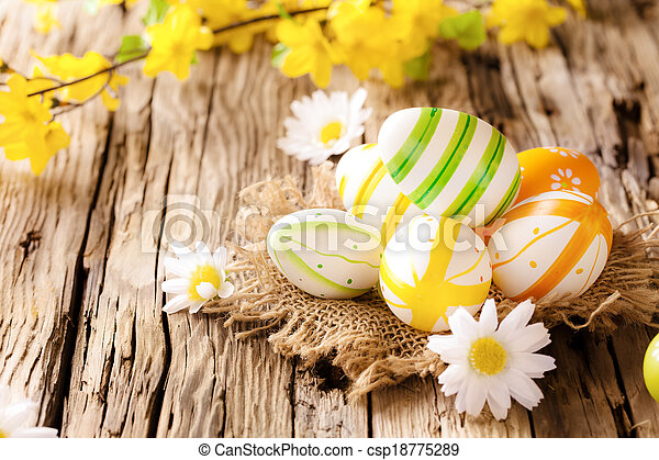 Easter eggs on wooden surface - csp18775289
