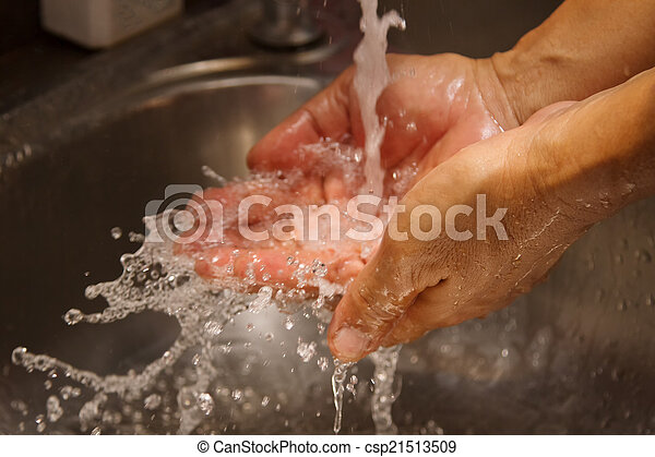 health occupation worker washing his hands under stream of pure - csp21513509