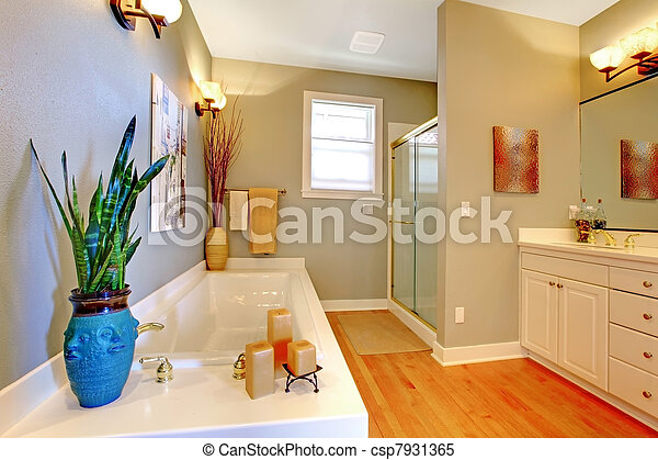 Large new remodeled bathroom with green walls and tub. - csp7931365