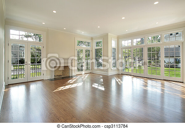Living room with wall of windows - csp3113784