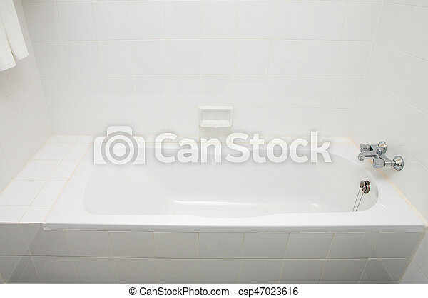 Luxury bath tub and faucet with water. - csp47023616