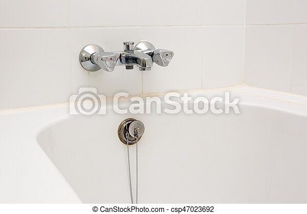 Luxury bath tub and faucet with water. - csp47023692