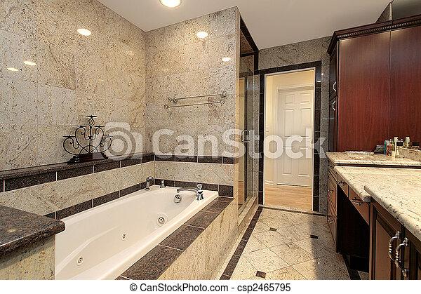 Master bath with marble tub - csp2465795