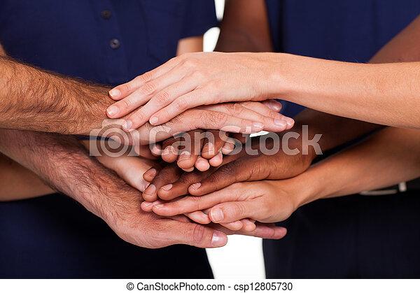 multiracial hands together - csp12805730