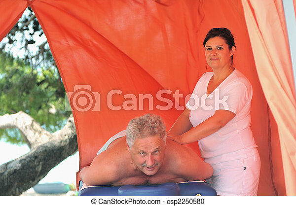 senior man have massage and spa therapy outside - csp2250580