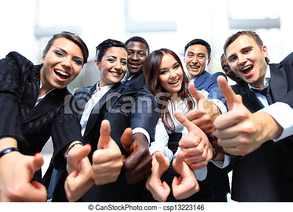Successful business people with thumbs up and smiling - csp13223146