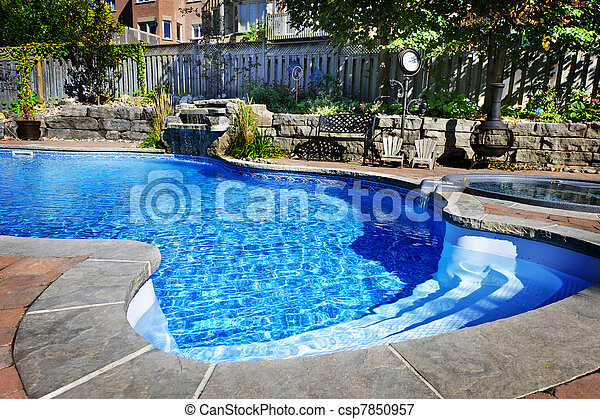 Swimming pool with waterfall - csp7850957