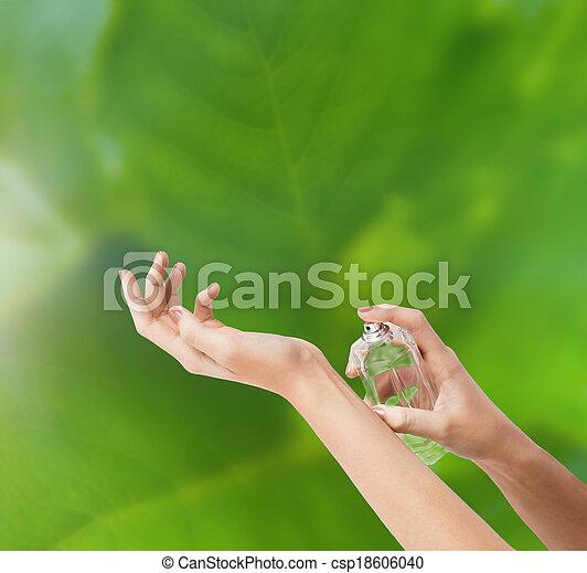 woman hands spraying perfume - csp18606040