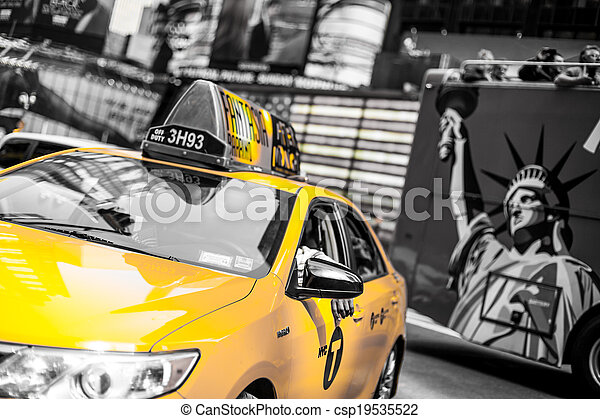 Yellow cab speeds through Times Square in New York, NY, USA. - csp19535522