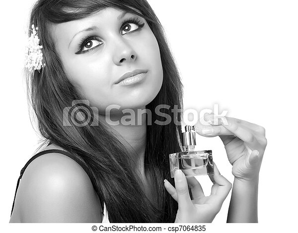 Young woman applying perfume on her neck. - csp7064835